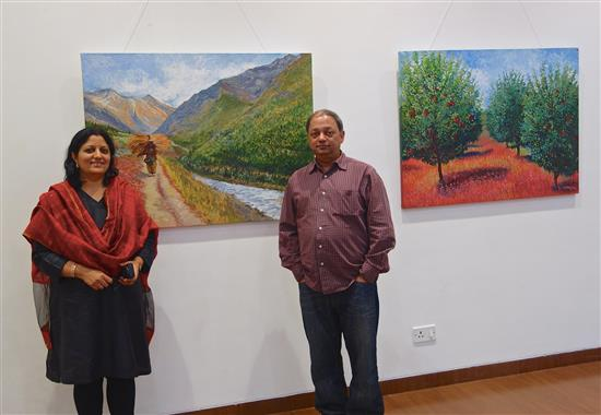 Chitra Vaidya and Milind Sathe with paintings from the show Call of the Hills at Nehru Centre, Mumbai