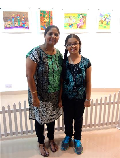 Participating child artist with parent at the gallery