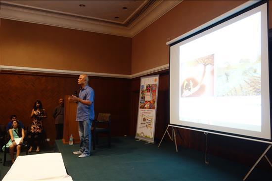 Senior artist Prabhakar Kolte delivering his talk at Harmony Hall, Nehru Centre, Mumbai