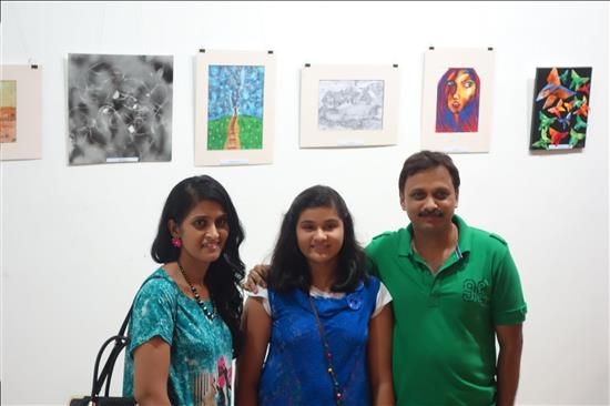 Young artist with parents