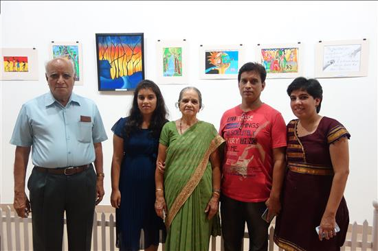 Yound artist with parents and grand parents