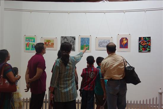 Paintings on display being keenly observed