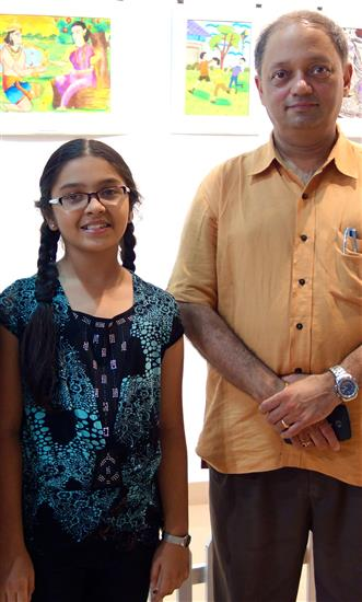 Milind Sathe with a participating child artist