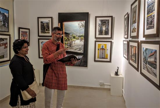 Ajit and Jyoti Kanitkar looking at the pictures from Milind Sathe's photography show