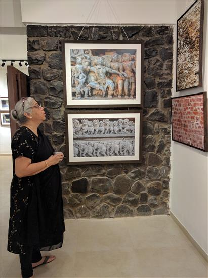 Deepa Lagoo looking at the pictures at Indiaart Gallery
