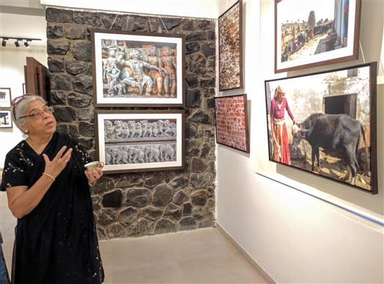 Deepa Lagoo looking at the pictures at Milind Sathe's photography show