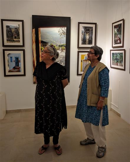 (L to R) Deepa Lagu and Yashodhara Bhalerao looking at the pictures at Milind Sathe's photography show
