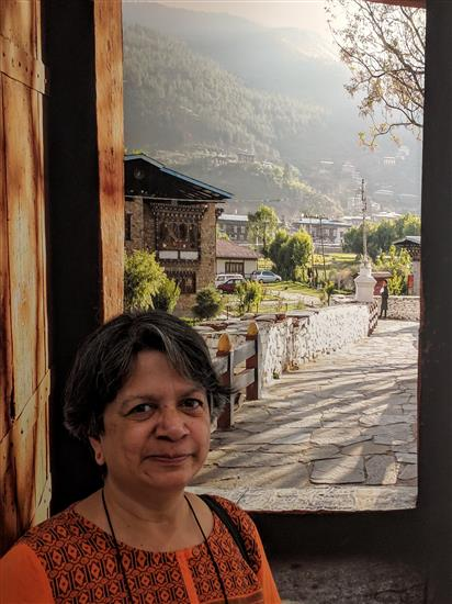 Dr. Arati Palsule in from of the picture - Looking out from Paro dzong