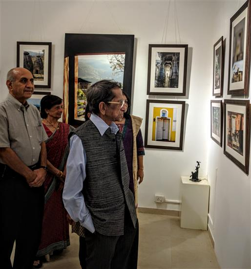 Eminent cartoonist Shri. S. D. (Shi. Da.) Phadnis looking at Milind Sathe's photography show at Indiaart Gallery