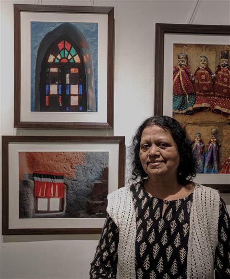 Hema Antarkar with the picture of Window from Dhangkar monastery at Milind Sathe's photography show