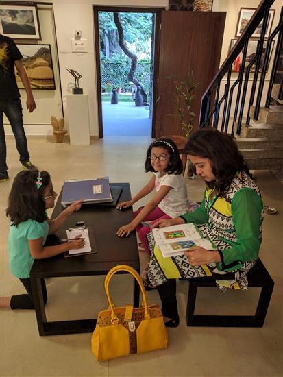 Neeraja Gadgil with daughters Riya and Nikita at Indiaart Gallery - going through Khula Aasmaan catalog