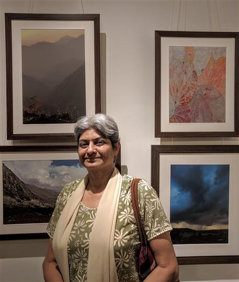 Shubha Gokhale in front of her favourite pictures from Milind Sathe's photography show
