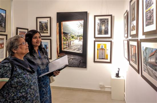 (L to R) Smt. Lath, Shilpa Lath looking at the pictures at Indiaart Gallery