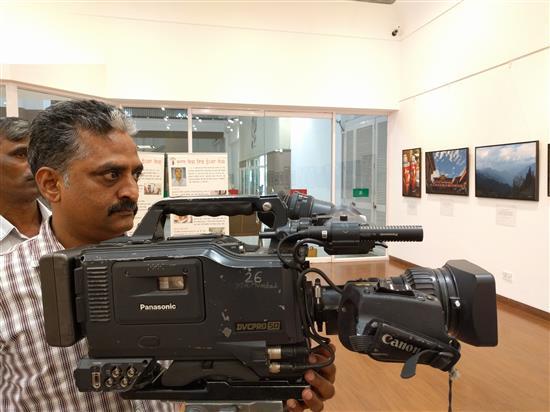 Doordarshan cameraman Mr. Lokabhiraman Naidu covering Milind Sathe's solo photography show exhibition
