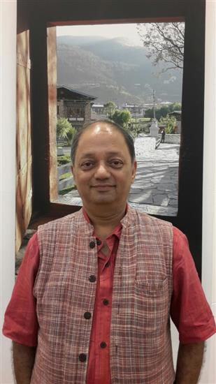 Milind Sathe in front of his photograph at Nehru Centre, Mumbai - August 2016