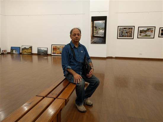 Milind Sathe at the gallery while the show is being put up