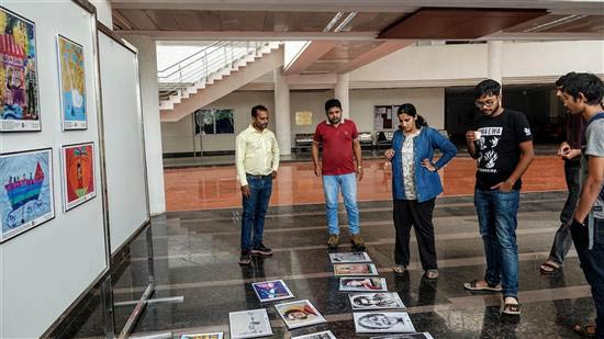 Planning the display at Khula Aasmaan art exhibition at IISER Pune