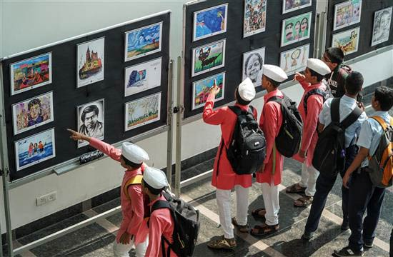 Children appreciating children's art at Khula Aasmaan painting exhibition at IISER Pune