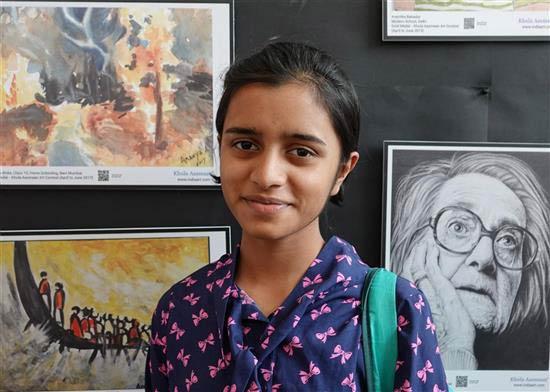 Manasi Jadhav, Khula Aasmaan medal winner, at the painting exhibition at IISER Pune