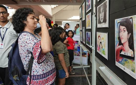 Taking picture of the selfie painting at Khula Aasmaan art exhibition