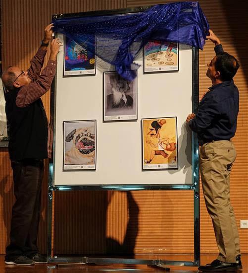 Milind Sathe and Dr. Sanjeev Galande unveil the art exhibition