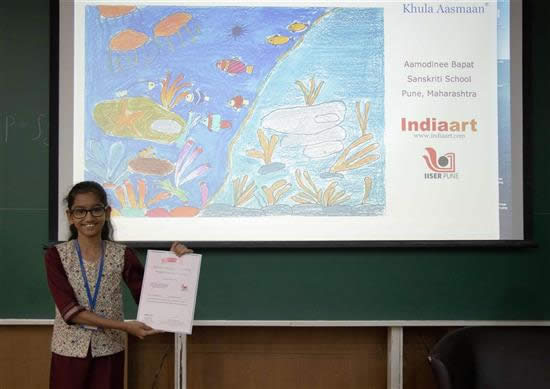 Aamodinee Bapat with her certificate