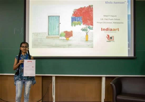 Mitali P. Kapure with her certificate