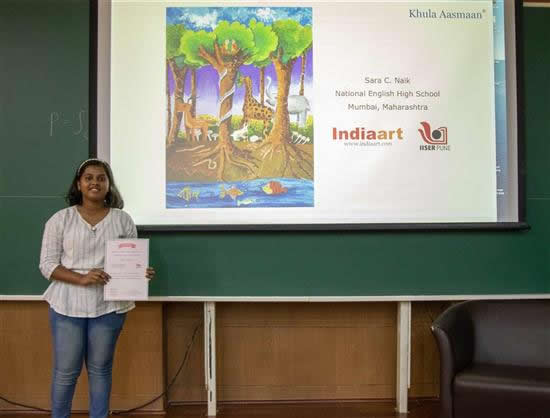 Sara C. Naik with her certificate