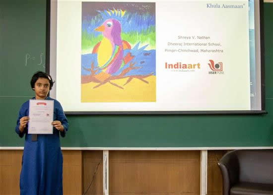 Shreya V. Nathan with her certificate