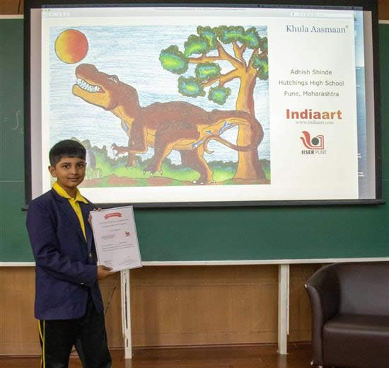 Adhish Shinde with his certificate