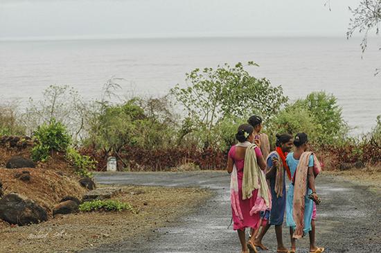 Women on a coastal road in Kokan