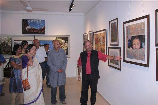 Visitors to Milind Sathe's photography exhibition at Indiaart Gallery