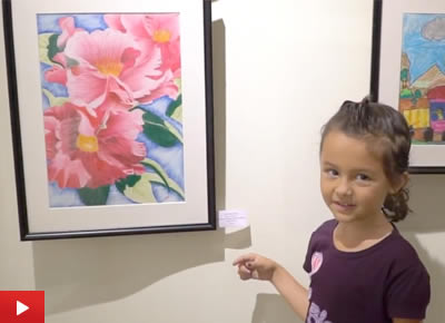 Young Yulia talks about paintings at Khula Aasmaan exhibition